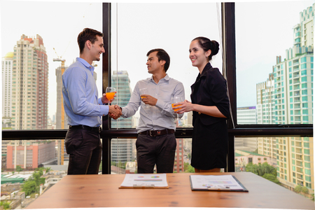 business people shaking hands for success agreement and drink champagne