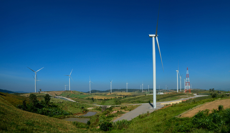 Windmills farm or Wind turbine power generators standing on green mountain against a blue sky, Located Khao Kho Phetchabun Province, Thailand