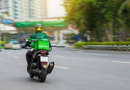 Motorcycle drivers rush to deliver food to customers who order online.