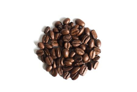 A pile of coffee beans on a white background