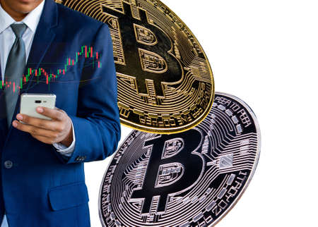 The concept of a businessman using a smart phone to trade bitcoins
