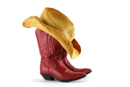 country western: Red leather cowboy boots with western straw hat isolated on a white background Stock Photo