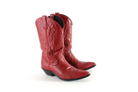 Red leather western boots isolated on a white background