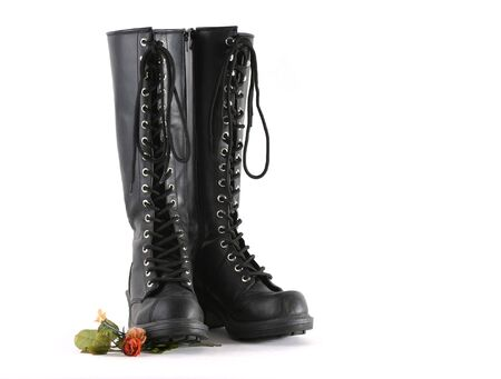 Black laced knee high boots isolated on white Stock Photo