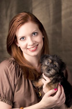 Attractive young woman with her adorable puppy