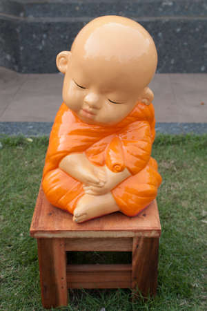 novice: novice monk  statue made of Mortar Pasteur