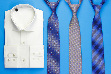 neck ties: Men shirt and more neck ties on blue background