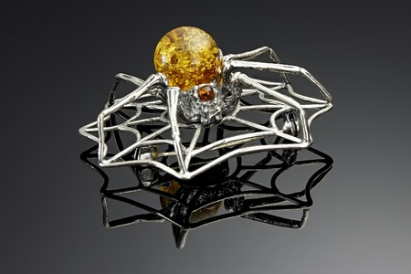 amber coloured: Silver spider brooch with stones of amber