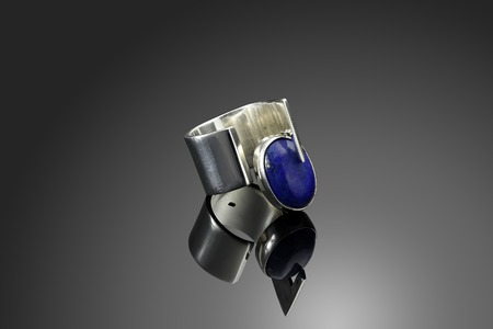 solid silver: Solid silver ring with lapiz lazuli on black Stock Photo