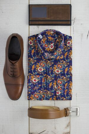 shirt: Mens accessoires sitting on a wooden background Stock Photo