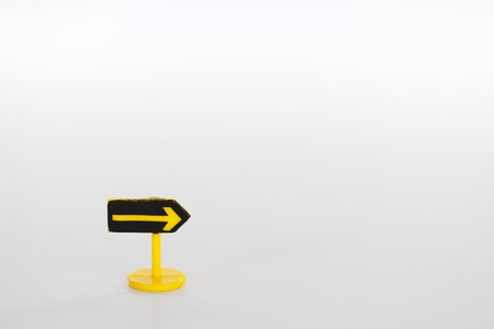 streetsign: Yellow street sign what showing direction on white background