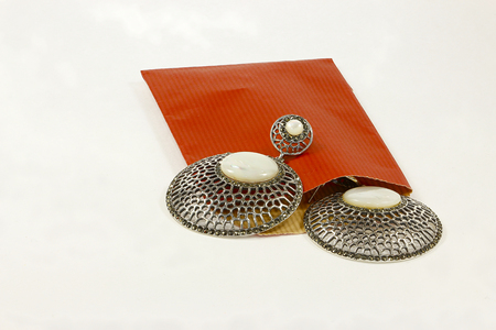onyx: Silver earrings with onyx stones and red envelope