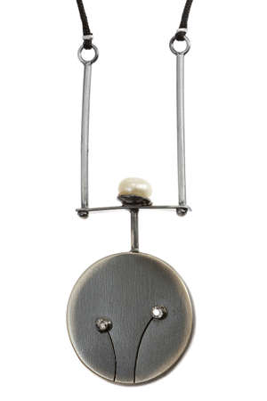 silk thread: Silver pendant on silk thread on white background Stock Photo