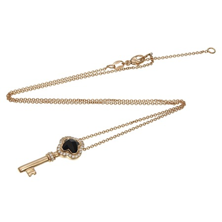 Gold chain with pendant in the shape of a key Stock Photo