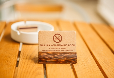 ashtray: A non-smoing room sign in a hotel balcony