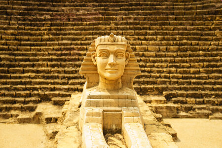 sphinx model close-up with pyramid  photo