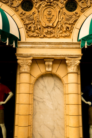 exquisite building exterior in roman european decoration with window display photo