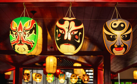 Japanese multi color face lamps hanging at gate photo