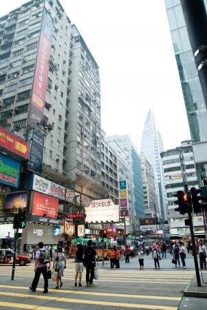 May 2011 Kowloon, Hong Kong - Pedestrians walking across Nathan Road street. Stock Photo