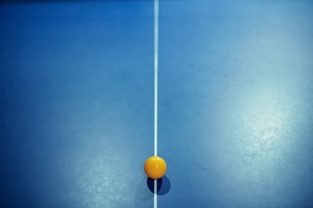 Image of a table tennis  ping pong  ball on center of table with leading line  photo