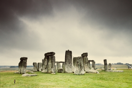 Stonehenge rock formation in field photo