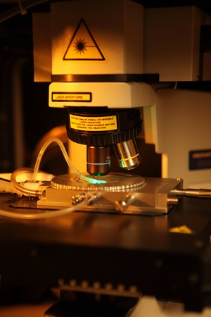 Laser processing of semiconductor nano components and movement of micro-particles