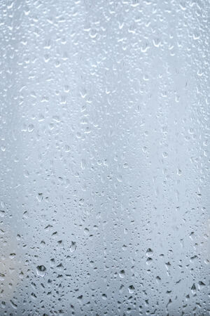 rainwater: Close up of water drops on window glass