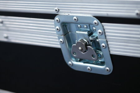 Close-up of music case turn lock photo