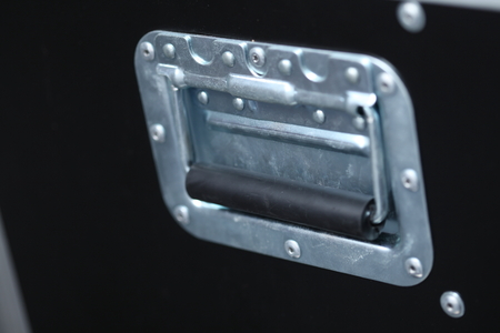 Close-up of music case handle photo