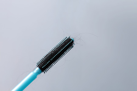 Hair brush with hair stuck in it photo