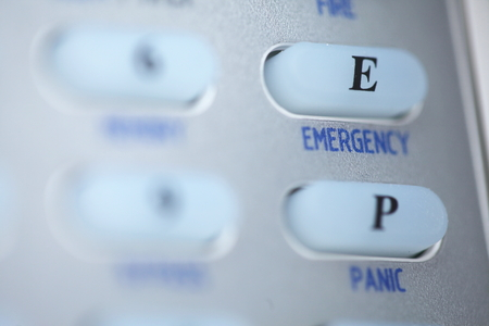 disarm: Emergency button of an alarm system keypad