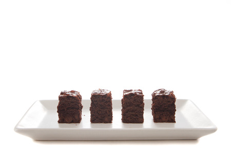 Homemade chocolate brownies served on a plate photo