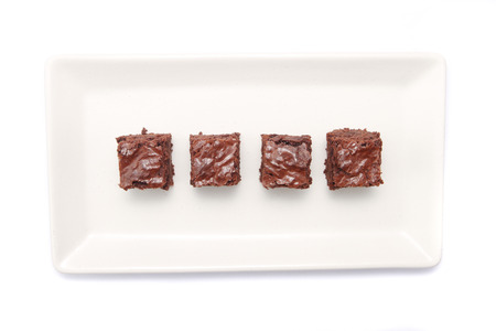 Top view of brownies on rectangle white plate