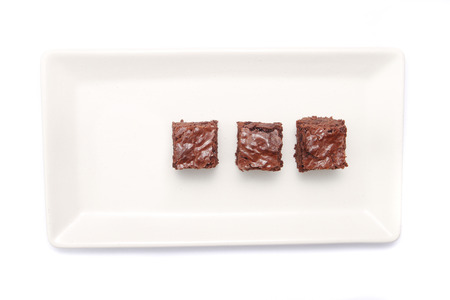Top view of brownies on rectangle white plate photo