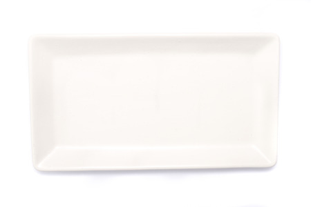 plan view: Top view of an empty rectangle white plate on white background. Stock Photo