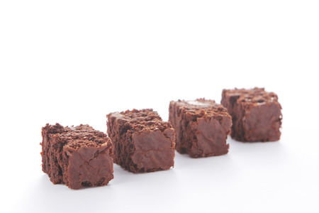 Selective focus four fresh homemade chocolate brownies focused on second brownie photo