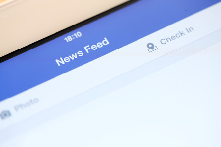 vimeo: close-up of tablet with social media news feed