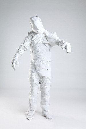 Mummy wrapped in paper roll Stock Photo