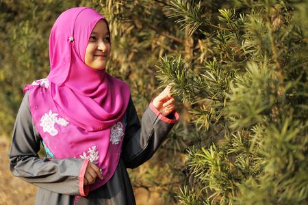 Beautiful muslim woman at the park photo