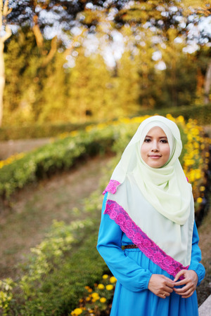 the latest models: Beautiful muslim woman at the park with flower background
