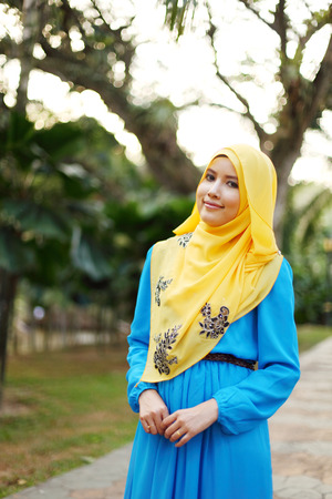 Beautiful muslim woman at the park photo
