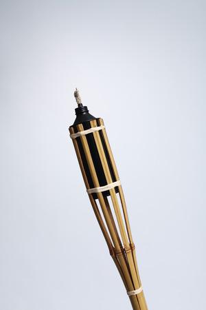Pelita or oil lamp on gradient grey background.