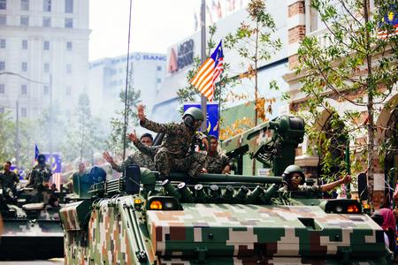 August 31st 2017, Kuala Lumpur Malaysia - The Royal Malaysian Army waving to crowd as they are marching towards Dataran Merdeka
