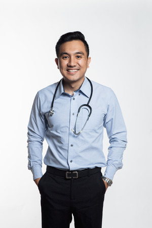 Professional asian doctor posing