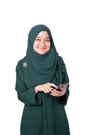 Malay woman using mobile phone Stock Photo