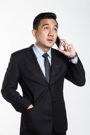 Man in suit talking over the phone Archivio Fotografico