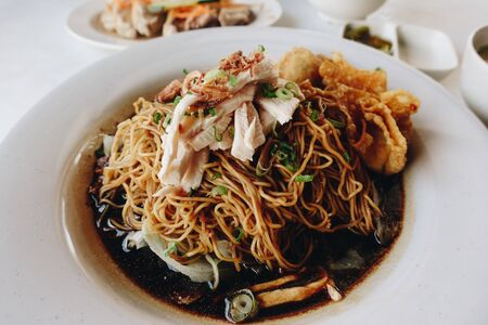 Wantan noodles, a Cantonese Chinese cuisine served dry with soy sauce and steamed chicken
