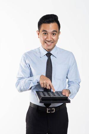 Man pointing to big calculator