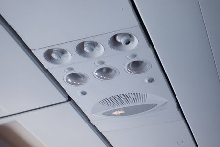 Overhead panel of an airplane aircraft with reading light, aircond and bell function