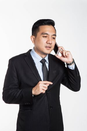 Man in suit talking over the phone
